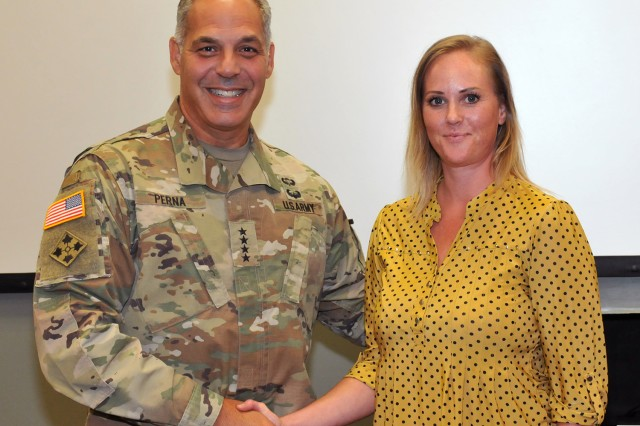 Gen. Gus Perna, Commander, U.S. Army Materiel Command, presented Nicole Jones, Security Assistance Directorate, AMC coins for her rapid development of combatant command priority foreign military sales case for precision guidance kits, which had high visibility by the Chief of Staff of the Army, August 13.
