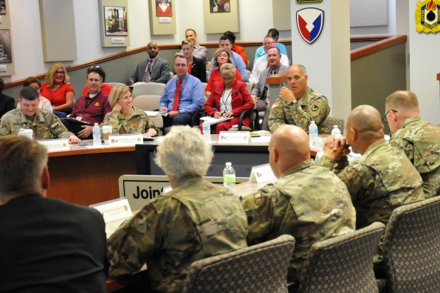 Brig. Gen. Michelle Letcher, Commander, Joint Munitions Command, listens as Gen. Gus Perna, Commander, Army Materiel Command, provides guidance during a quarterly update on Munitions Readiness and Strategic Support focus areas, August 13.