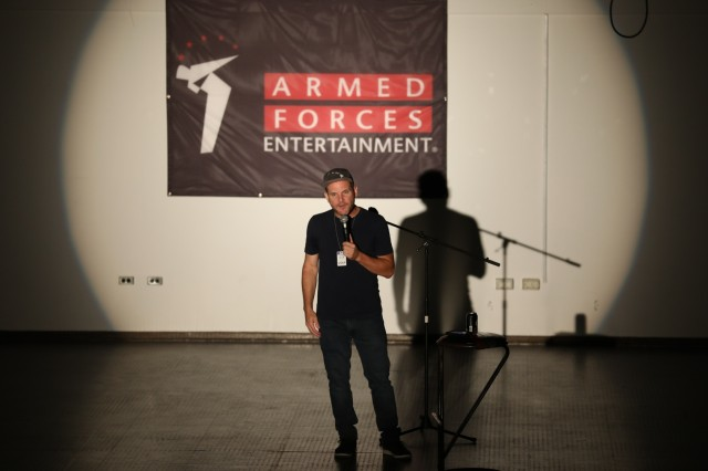 World Wide Comedy tour headliner Johnny Cardinale performs his set as part of an Armed Forces Entertainment show at Camp Bondsteel, Kosovo, Aug. 5, 2019. This was his 18th AFE tour, which has allowed him to travel to over 60 countries. (U.S. Army photo by Spc. Grant Ligon, 40th Public Affairs Detachment)