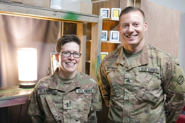 1st Lt. Lori Blakeway and Sgt. Cory Nottingham, 1972d Medical Detachment, stand for a photo at Erbil, Iraq, July 29, 2019. (U.S. Army National Guard photo by Staff Sgt. Veronica McNabb)