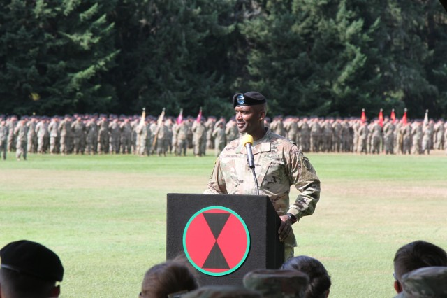 Maj. Gen. Xavier T. Brunson, incoming 7th Infantry Division commanding general, addresses the crowd at a change of command ceremony on Watkins Field at Joint Base Lewis-McChord Aug. 13.