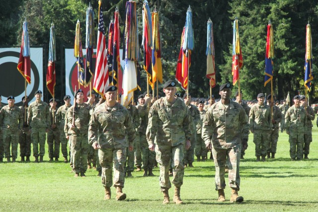 Maj. Gen. Willard Burlseon III, outgoing 7th Infantry Division commanding general walks with Lt. Gen. Gary Volesky, commanding general, I Corps, and Maj. Gen. Xavier Brunson, incoming 7th Inf. Div. commanding general during a change of command ceremony at Joint Base Lewis-McChord Aug. 13.