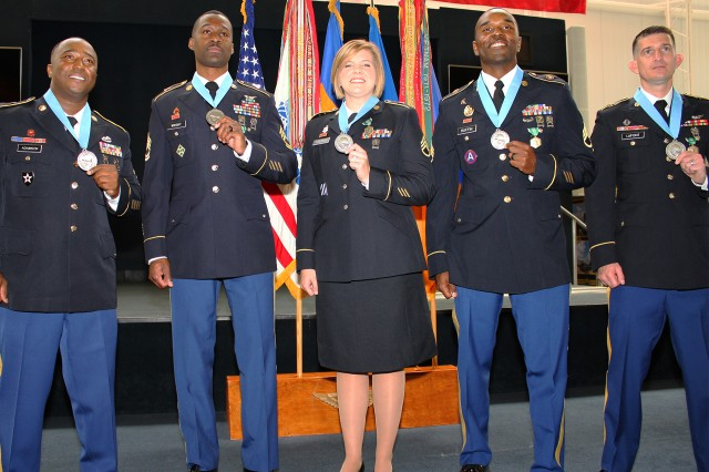 The newest Fort Rucker Sergeant Audie Murphy Association inductees pose for a photo after their induction ceremony Aug. 12. Pictured are 1st Sgt. Jerry G. Adamson, Sgt. 1st Class Richard Wright, Staff Sgt. Katherine R. Andrus, Staff Sgt. Eric D. Ruffin Jr. and Sgt. Hans C. Lafont.