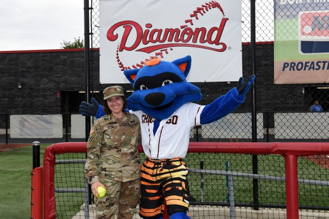 Maj. Rebecca Spohr, assigned to the 85th U.S. Army Reserve Support Command, pauses for a photo with Swiper, the mascot of the Chicago Bandits softball team, before the Bandits home game vs. the United States Specialty Sports Association Pride team at Parkway Bank Sports Complex, August 11, 2019, in Rosemont, Illinois. Spohr received an honor at the game throwing in a ceremonial first pitch. August battle assembly was the last BA for Spohr as the Headquarters and Headquarters Company Commander. (U.S. Army Reserve photo by Capt. Michael Ariola)