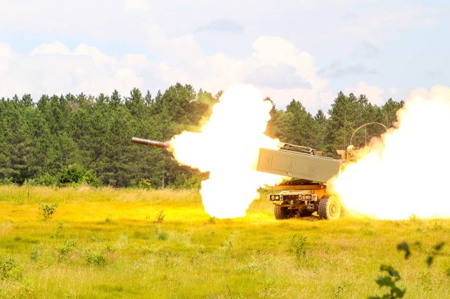 Soldiers from 182nd Field Artillery fires their High Mobility Artillery Rocket system during Northern Strike 2019 at Camp Grayling, Michigan, July 23, 2019. Northern Strike 19 is a National Guard Bureau-sponsored exercise uniting service members from more than 20 states, multiple service branches and numerous coalition countries.
