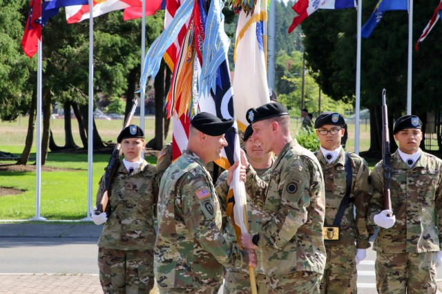 Command Sgt. Maj. Shane E. Pospisil (left) receives the I Corps colors from Commanding General, Lt. Gen. Gary J. Volesky (right) during an Assumption of Responsibility ceremony Aug. 12, 2019, in front of I Corps headquarters on Joint Base Lewis-McChord, Washington.  Command Sergeant Major Shane E. Pospisil assumed his duties as the senior enlisted advisor of America's First Corps after coming from his last position as the Command Sergeant Major of the First Cavalry Division, Fort Hood, Texas.
