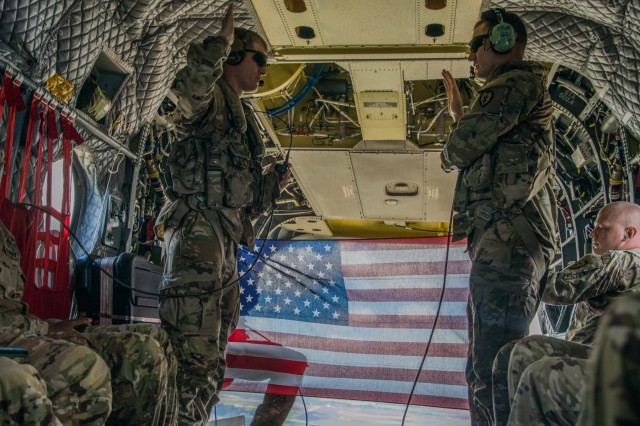 U.S. Army Soldier Sgt. Damian Childress, assigned to 25th Infantry Division  reenlists inside a CH-47 Chinook helicopter over the island of O'ahu, HI Aug 13, 2019. (U.S. Army Photo by Sgt. Sarah D. Sangster)