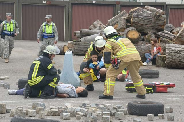 """First responders work together to triage """"victims"""" during exercise Stallion Shake, July 12, 2014. To mitigate potential terrorist attack, August is Antiterrorism Awareness Month. P"""