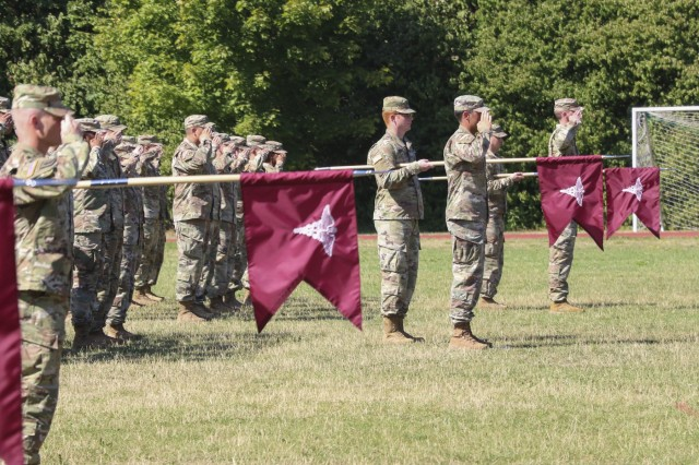 Soldiers with Landstuhl Regional Medical Center's Troop Command stand in formation during a change of command ceremony where Lt. Col. Stephanie Sido relinquished command to Lt. Col. Christina Buchner, at LRMC, July 30.