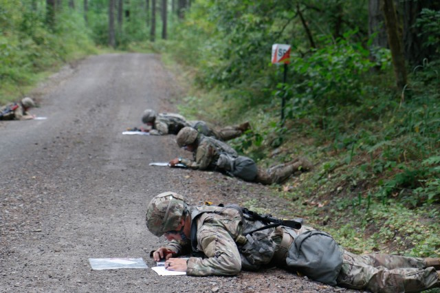 Medical Soldiers plot points for day land navigation on the second day of testing during the Expert Field Medical Badge at Joint Base Lewis McChord, Washington, Aug. 9