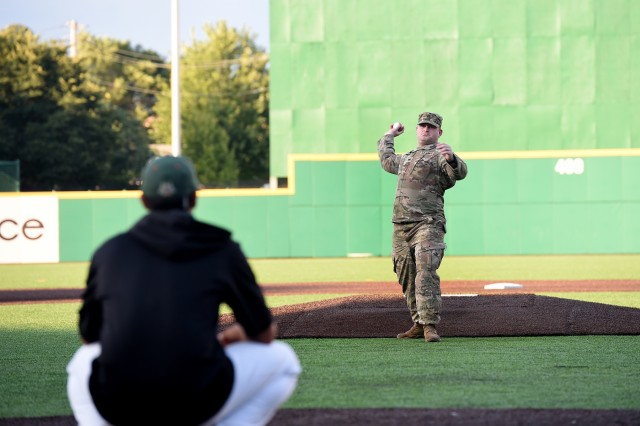 Army Reserve Staff Sgt. Clifford Arrington, Information Systems noncommissioned officer assigned to the 85th U.S. Army Reserve Support Command, throws in a ceremonial first pitch before a Joliet Slammers home game, August 13, 2019 in Joliet, Illinois. Arrington was honored, throwing in a ceremonial first pitch, at the game during pre-game activities. Arrington has deployed twice to Iraq in support of Operation Iraqi Freedom and once to Afghanistan in support of Operation Enduring Freedom across his twelve years of service in the Army. (U.S. Army Reserve photo by Anthony L. Taylor)