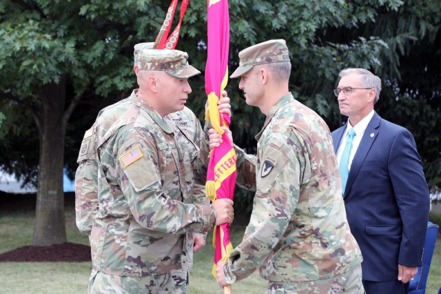 From the left, Sergeant Major Rich Huff receives the Letterkenny Army Depot colors from Col. Gregory Gibbons as he takes on his new role as commander. Bill Marriott, right, executive deputy of the U.S. Army Aviation and Missile Command, presided over the ceremony. U.S. Army Photo by Pam Goodhart