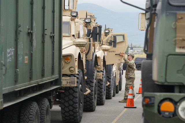 U.S. Army Spc. Cody Dunn, a chemical specialist and native of Cheyenne, WY, assigned to the 4th Infantry Brigade Combat Team. (Airborne), 25th Infantry Division, U.S. Army Alaska, inspects a vehicle for transportation operations on Joint Base Elmendorf-Richardson, Alaska, Aug. 14, 2019, as part of a joint readiness exercise. This exercise allows the Army, Air Force and Navy to move material and personnel using ground, sea and air methods of transportation. (U.S. Air Force photo/Justin Connaher)
