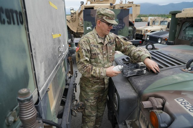 Army Sgt. Jay Jensen, a Multichannel Transmission Systems Operator-Maintainer and native of Salt Lake City, Utah, assigned to Headquarters and Headquarters Company, 725th Brigade Support Battalion (Airborne), 4th Infantry Brigade Combat Team. (Airborne), 25th Infantry Division, U.S. Army Alaska, prepares to paint identifying numbers on a vehicle prior to transportation operations on Joint Base Elmendorf-Richardson, Alaska, Aug. 14, 2019, as part of a joint readiness exercise. This exercise allows the Army, Air Force and Navy to move material and personnel using ground, sea and air methods of transportation. (U.S. Air Force photo/Justin Connaher)