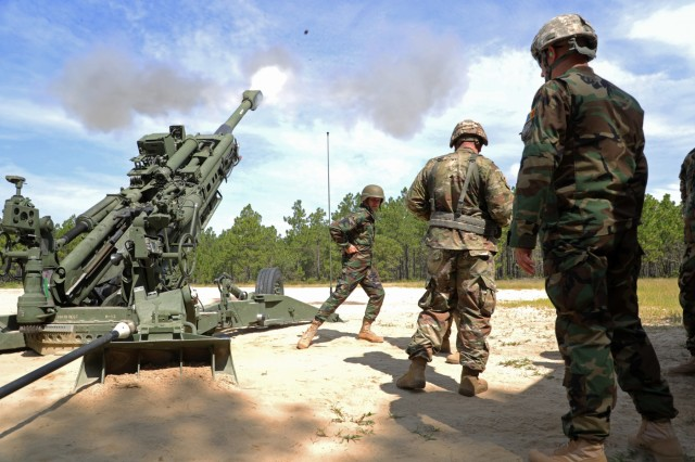 Moldovan National Army Lt. Victor Suceanu, a field artillery officer, fires an M777A2 Howitzer during a visit to the 139th Regional Training Institute at Fort Bragg on Aug. 12, 2019. The North Carolina National Guard has partnered with Moldova for over 20 years as part of the State Partnership Program, which is created to foster military and civil sector bonds between former Soviet Union countries while conducting military-to-military and civilian-to-military activities to maintain international defensive security and to increase peace and stability across Europe.