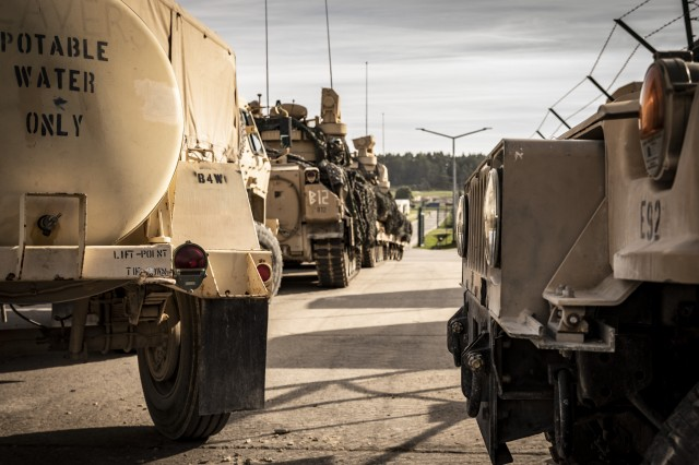 Soldiers with the 1st Engineer Battalion, 1st Armored Brigade Combat Team, 1st Infantry Division stage vehicles and equipment prior to movement to the field at the start of a force on force exercise during Combined Resolve XII at Hohenfels Training Area, Germany Aug. 16, 2019. Combined Resolve is a biannual U.S. Army Europe and 7th Army Training Command-led exercise intended to evaluate and certify the readiness and interoperability of US forces mobilized to Europe in support of Atlantic Resolve.