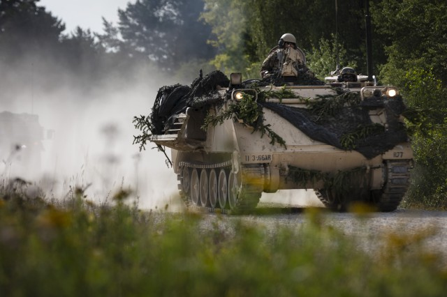 "U.S. Army vehicles belonging to the 3rd Battalion, 66th Armored Regiment, 1st Armored Brigade Combat Team, 1st Infantry Division, roll into ""the box"" on a convoy to their location at the start of the culminating force on force exercise during Combined Resolve XII at Hohenfels Training Area, Germany Aug. 15, 2019. Combined Resolve is a biannual U.S. Army Europe and 7th Army Training Command-led exercise intended to evaluate and certify the readiness and interoperability of US forces mobilized to Europe in support of Atlantic Resolve."
