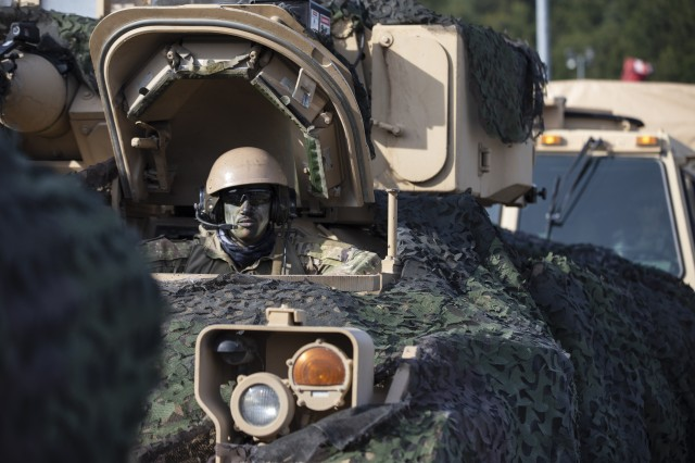 "U.S. Army Pfc. Isaac Terry, a combat engineer and bradley driver with 1st Engineer Battalion, 1st Armored Brigade Combat Team, 1st Infantry Division, awaits orders for a convoy to roll out to their location in ""the box"" at the start of the culminating force on force exercise during Combined Resolve XII at Hohenfels Training Area, Germany Aug. 15, 2019. Combined Resolve is a biannual U.S. Army Europe and 7th Army Training Command-led exercise intended to evaluate and certify the readiness and interoperability of US forces mobilized to Europe in support of Atlantic Resolve."