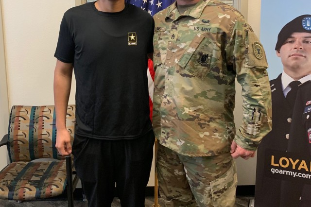 Luis Enrique Pinto Jr. with his recruiter, Staff Sgt. Philip Long. Luis lost 113 pounds in seven months in order to pass the Army's weight requirements. With help from his recruiter, he enlisted as a 14E, which is responsible for operating and maintaining Patriot weapon systems, and plans to report to basic training in September.