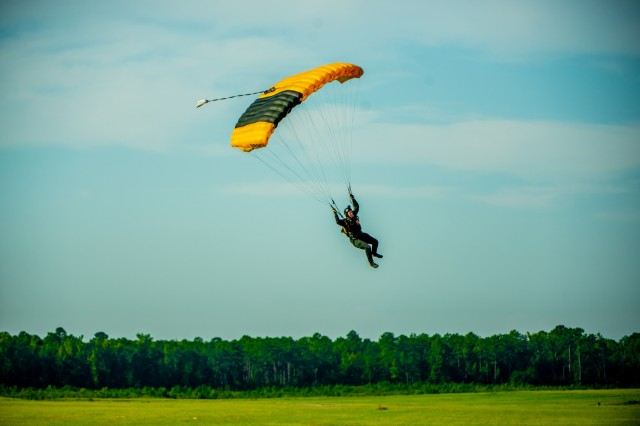 A Soldier with the U.S. Army Parachute Team jumps onto Fryar Drop Zone. Maneuver Center of Excellence and Fort Benning commemorated the 2019 National Airborne Day Aug. 16 at Fryar Drop Zone at Fort Benning. National Airborne Day is the anniversary of the first paratrooper test jump, which took place at Fort Benning 79 years ago. The U.S. Army Parachute Team from Fort Bragg, North Carolina, the Silver Wings jump team from Fort Benning and the volunteer Liberty Jump Team performed parachute jumps to honor the history of U.S. Army airborne Soldiers.