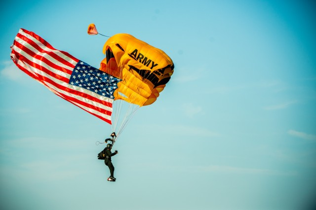 A member of the U.S. Army Parachute Team, commonly known as the Golden Knights, parachutes onto Fryar Drop Zone during the playing of the national anthem. Maneuver Center of Excellence and Fort Benning commemorated the 2019 National Airborne Day Aug. 16 at Fryar Drop Zone at Fort Benning. National Airborne Day is the anniversary of the first paratrooper test jump, which took place at Fort Benning 79 years ago. The U.S. Army Parachute Team from Fort Bragg, North Carolina, the Silver Wings jump team from Fort Benning and the volunteer Liberty Jump Team performed parachute jumps to honor the history of U.S. Army airborne Soldiers.