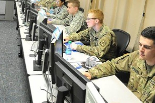 The eyes of Team Alpha's seven Army and Air Force ROTC cadets are glued to their dual monitors as they prepare their two virtual computer systems' defenses and navigate network structures during the Air Force Institute of Technology's Advanced Cyber Education program here. The program hosted 45 Air Force and Army ROTC cadets and split them into seven green-blue teams, putting each team through a wide variety of cybersecurity related disciplines to develop original thinkers and technical leaders who will be prepared to solve real-world problems in the area of cybersecurity.