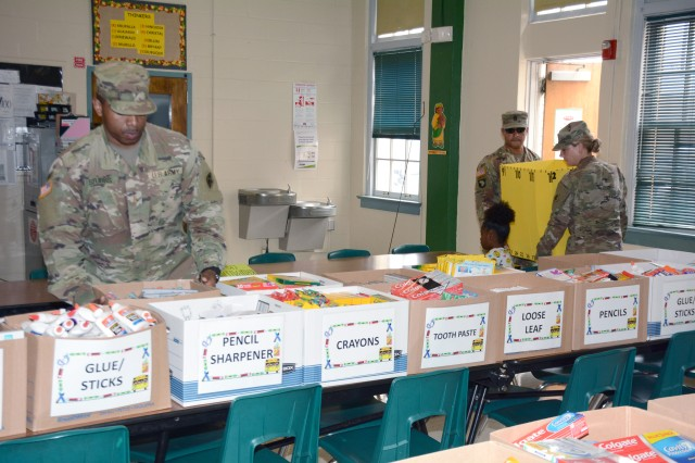 187th Medical Battalion Soldiers delivering donated supplies at Briscoe Elementary School.