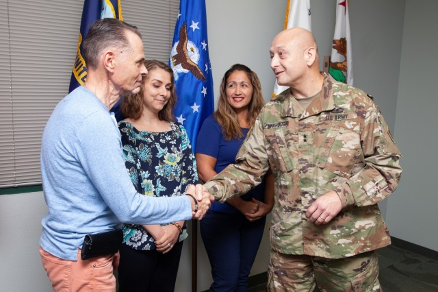 Maj. Gen. Anthony Funkhouser, U.S. Army Corps of Engineers Deputy Commanding General for Military and International Operations, presents coins in appreciation of the work accomplished by USACE Sacramento District employees at Military Ocean Terminal Concord, Calif., on Aug. 1, 2019. (U.S. Army photo by Ken Wright)