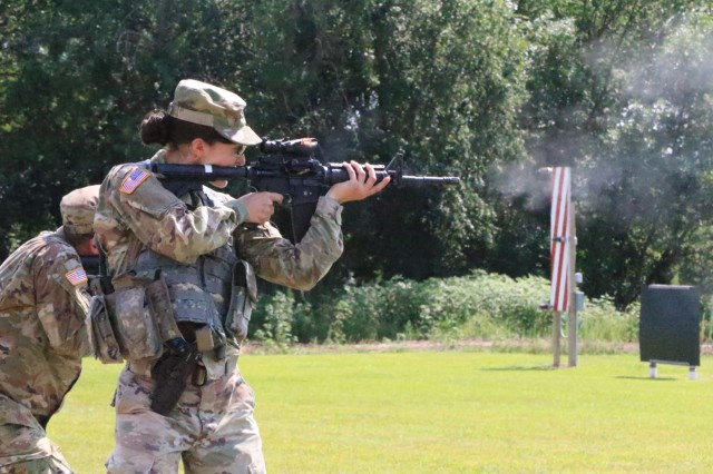 Spc. Micah Redenbaugh, a supply specialist assigned to the 170th Support Maintenance Company, fires at her target during the Reflexive Fire vent, Aug. 10, at the annual Adjutant General's Marksmanship Competition (TAG Match) hosted at the Great Plains Joint Training Center's small arms range in Salina, Kansas. Redenbaugh was one of many service members in the Kansas National Guard who competed for the first time at the TAG Match.