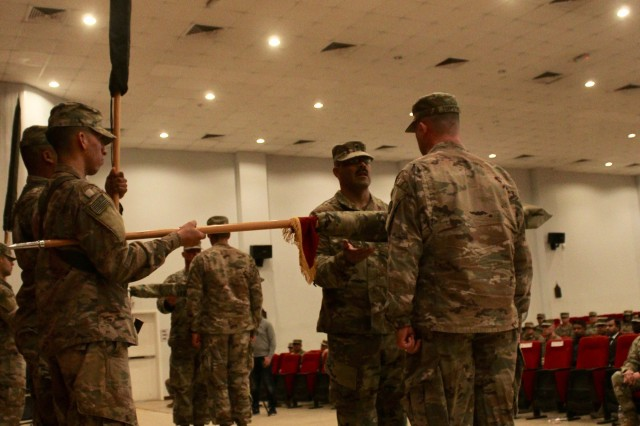 Command Sgt. Maj. Mario F. Miranda and Lt. Col. Richard J. Terpstra, 1173d Transportation Battalion commander, case the unit's colors during their transfer of authority ceremony held at Camp Arifjan, Kuwait, Aug. 13, 2019. The Hard Hats handed authority to the 1188th Transportation Battalion. (U.S. Army photo by Claudia LaMantia)