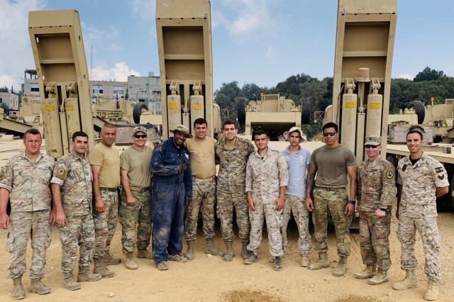 U.S. Army Soldiers from the 1st Theater Sustainment Command's Strategic Operations and Plans team, the U.S. Army Reserve's 77th Sustainment Brigade, and the 158 Military Engagement Team, Arizona Army National Guard gather with members of Lebanese Armed Forces July, 24, 2019, at forward operating base Ghosta, Lebanon, during a five-day staff exchange focusing on Heavy Equipment Transporter equipment operations, operator maintenance, and recovery operations. (Courtesy Photo)