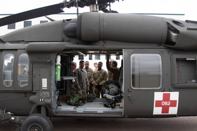The 683rd Engineer Detachment reviews UH-60 shutoff procedures at CSTX 86-19-04 at Fort McCoy, Wisconsin Aug. 1, 2019. The firefighters learned shutdown procedures on the UH-60 Black Hawk, especially with throttles, bottles and batteries, and extrication procedures for members of the flight crew. (U.S. Army Reserve Photo by Sgt. Sean Harding)