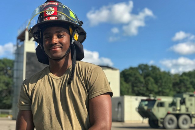 Spc. Mikail Greene, from Mobile, Alabama, stands in front of a fire training-tower at CSTX 86-19-04 at Fort McCoy, Wisconsin Aug. 1, 2019. The firefighters learned shutdown procedures on the UH-60 Black Hawk, especially with throttles, bottles and batteries, and extrication procedures for members of the flight crew (U.S. Army Reserve Photo by Sgt. Sean Harding)