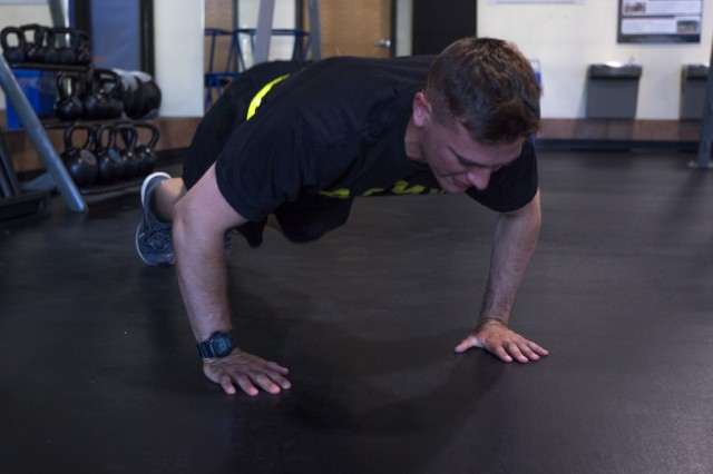 Cadet Bryan Abell, Michigan State University ROTC, rests conducts a burpee Aug. 16, 2019, at Fort Knox, Ky. Abell recently set the world record for most chest-to-ground burpees accomplished in 12 hours, accomplishing 4,689 burpees as part of an effort to raise money and awareness for wounded veterans.