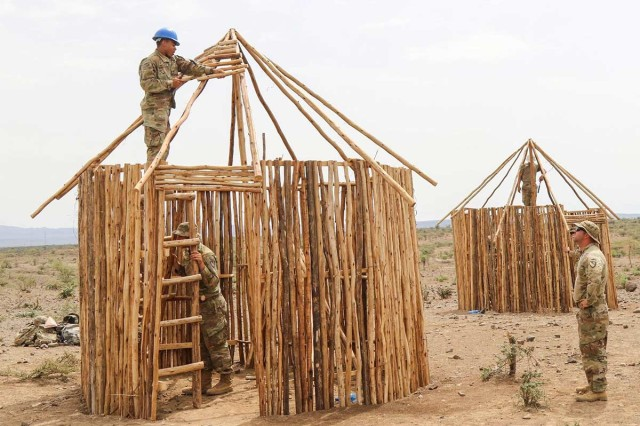 Soldiers assigned to the 615th Engineer Construction Company, 4th Engineer Battalion, build Somali-style huts for a training area at the Hurso Training Center near Dire Dawa, Ethiopia, July 18, 2019, as part of Justified Accord 19. Justified Accord is an annual combined, joint exercise designed to strengthen partnerships, increase interoperability and enhance the capability and capacity of international participants to promote regional security and support peacekeeping operations for the African Union Mission in Somalia (AMISOM).