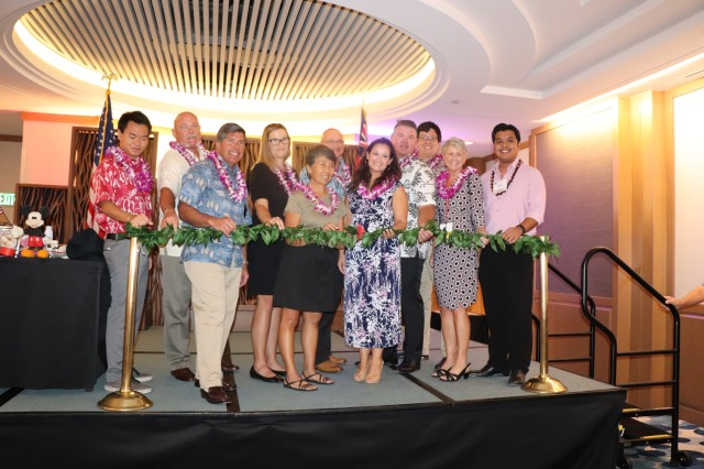 ALA members, state representatives, commissary and exchange officials and the late Sen. Daniel Akaka's daughter ready to cut the ribbon to the food show opening.
