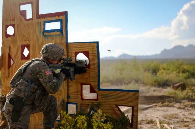 FORT BLISS, Texas -- Sgt. John Sis, an infantryman assigned to 4th Battalion, 70th Armor Regiment, 1st Armored Brigade Combat Team, 1st Armored Division and a native of Annapolis, Maryland, fires an M4 carbine at a target during the Iron Sniper 2019 competition August 14, at Dona Ana Range Complex, New Mexico. Sis, a part of the winning team, will further go on to compete next April, representing 1AD at the International Sniper Competition in Fort Benning, Georgia.