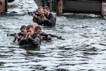 Guard dives into water survival training in Poland