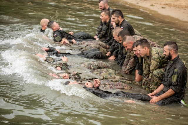 U.S. and Polish Soldiers conduct extensive water survival training during day one of the Water Survival Course hosted by 15th Mechanized Brigade in Gizycko, Poland, Aug. 12.