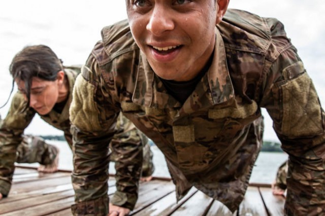 Spc. Sean Cummings of the 278th Armored Cavalry Regiment deployed in Poland does pushups during day one for the Water Survival Course hosted by 15th Mechanized Brigade in Gizycko, Poland, Aug. 12.