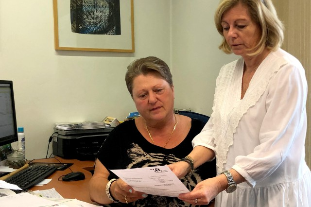 Sissi Kösling, left, and Petra Lessoing, both of the German-American Community Office, work together to find out details about a speeding ticket sent to an American civilian recently.