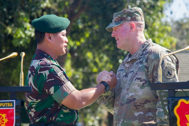 Indonesian Army Maj. General Tri Yuniarto and Maj. Gen. Pete Johnson, Deputy Commanding General for the United States Army, Pacific, shake hands after their respective speeches during the 2019 Garuda Shield opening ceremony Aug. 19, 2019, at Dodiklatpur, Indonesia. Garuda Shield is an annual, bilateral military partnership sponsored by the U.S. Army Pacific and hosted annually by Tentara Nasional Indonesia. (U.S. Army photo by Pfc. Ezra Camarena, 28th Public Affairs Detachment)