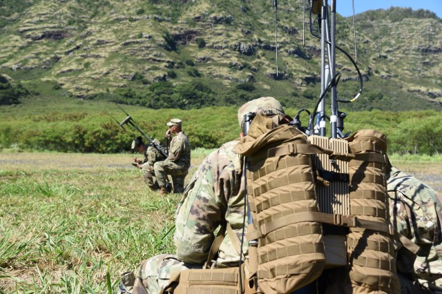 Electronic warfare specialists assigned to 2nd Infantry Brigade Combat Team, 25th Infantry Division, conduct radio checks before fielding new equipment. These Soldiers are fielding the new Versatile Radio Observation and Direction, or VROD, Modular Adaptive Transmission system, known as VMAX.