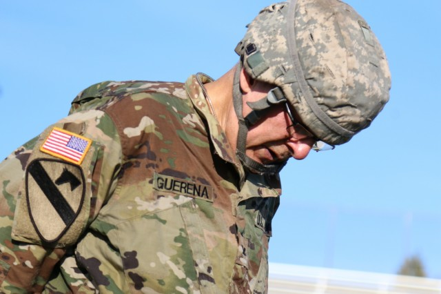 Col.  Fernando Guerena , chief medical officer from Madigan Army Medical Center, takes a second to catch his breath after completing the 12-mile ruck march on the last day of Expert Field Medical Badge competition at Joint Base Lewis McChord, Washington, Aug. 14.