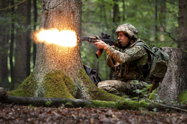 A Ukrainian mechanized infantry soldier fires at Opposing Forces (OPFOR) trying to advance forward, during the culminating force on force exercise of Combined Resolve XII at the Joint Multinational Readiness Center in Hohenfels, Germany Aug. 19, 2019. Combined Resolve is a biannual U.S. Army Europe and 7th Army Training Command-led exercise intended to evaluate and certify the readiness and interoperability of US forces mobilized to Europe in support of Atlantic Resolve.  (U.S. Army photo by Sgt. Thomas Mort)