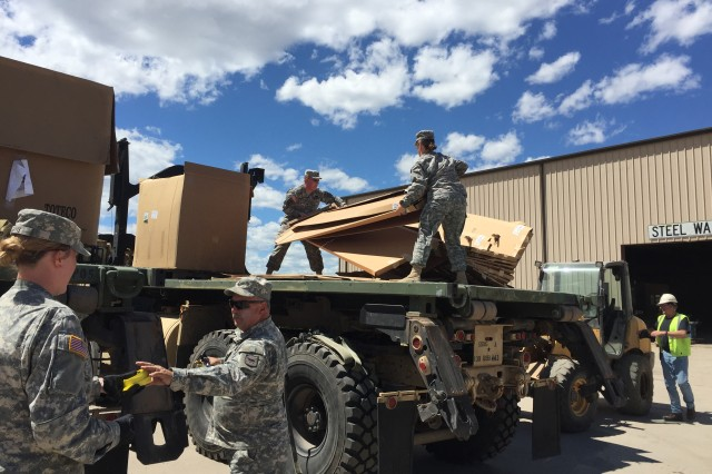 The South Dakota Army National Guard incorporates recycling into annual training activities using the help of one of their transportation units to haul recyclables from the geographically isolated camps back to recyclers in town. Using equipment already found in the camps, the transportation unit loaded up 8-10 recycling containers per load.