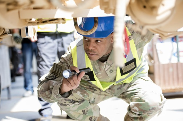 Sgt. 1st Class Roy Carson, maintenance quality assurance for wheeled vehicles, 401st Army Field Support Battalion-Kuwait inspects the undercarriage of a PLS 1076 trailer before certifying the contractor's repairs Aug. 10 at Army Prepositioned Stocks-5, Camp Arifjan, Kuwait.