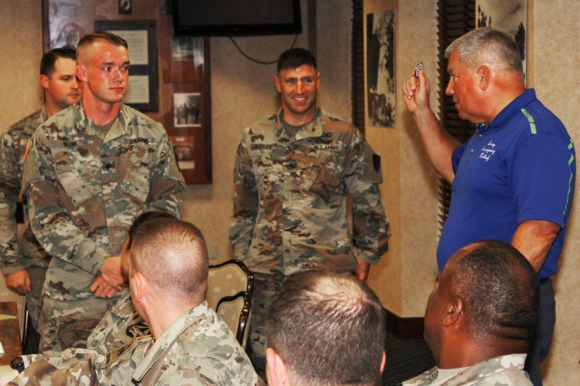 Retired Lt. Gen. Raymond V. Mason, Army Emergency Relief director, recognizes three Soldiers (Staff Sgt. Kyle Bejma; B Company 1st Battalion, 223rd Aviation Regiment AER campaign unit coordinator; Spc. Jason Blum; U.S. Army Aeromedical Research Laboratory AER campaign unit coordinator; and Staff Sgt. Jim Burley; A Co. 1-223rd Avn. Regt. AER campaign unit coordinator) who helped make this year's AER awareness campaign a success. Mason visited Fort Rucker Aug. 19 to meet with Soldiers and leadership to share information and gain feedback on the organization and how it helps Soldiers help Soldiers.