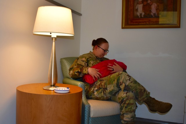 The Ansbach Health Clinic officially opened their new lactation room for breastfeeding moms during a ribbon cutting ceremony Aug. 22, 2019. Sgt. Rochelle Walsingham, a medic at the health clinic, uses the room on a regular basis.