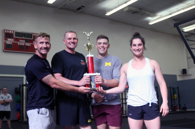 The Fort Sill Marine Artillery Detachment won the Fittest Brigade award. From left are  Staff Sgt. Jesse Garner, Maj. Gen. Wilson A. Shoffner, Fires Center of Excellence and Fort Sill commanding general, 2nd Lt. Alec Mayham, and 2nd Lt. Kylee Daitz. The event, Aug. 17, 2019, drew 52 CrossFit athletes.